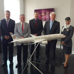 An Etihad flight staff member joins the airline's management team members Michael Kohlstrand, James Hogan, Kevin Knight and Geert Bovan. // © 2014...