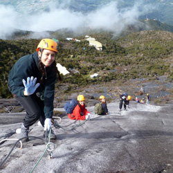 The writer climbing Mount Kinabalu's via ferrata. // (c) 2013 Leslie Kehrer