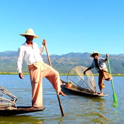 Fishermen in Myanmar's Inle Lake famously row with one foot. // © 2013 Yvonne Horn