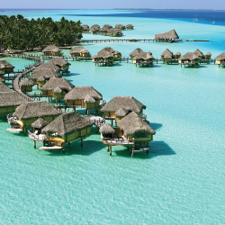 Le Tahaa offers Polynesian-style overwater bungalow suites. // © 2013 Le Tahaa Island Resort & Spa