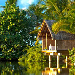 Le Tahaa Island Resort & Spa features overwater hut accommodations. // © 2014 Le Le Tahaa Island Resort & Spa