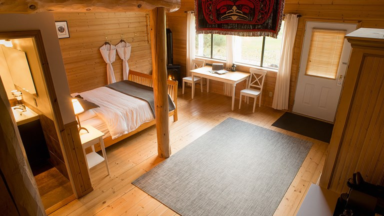 Guests at the lodge stay in timber-framed cabins.