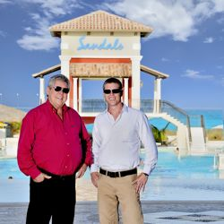 "Gordon ""Butch"" Stewart, chairman of Sandals Resorts International and Adam Stewart, CEO of Sandals Resorts International. // © 2013 Sandals Resorts..."