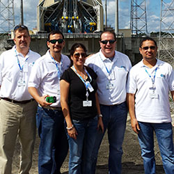 The Royal Caribbean team in front of a rocket that launched an O3b satellite in French Guyana // © 2014 Royal Caribbean International