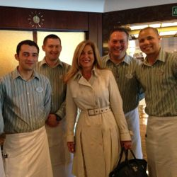 New president and COO of Crystal Cruises Edie Bornstein poses with members of the Crystal crew. // © 2013 Crystal Cruises