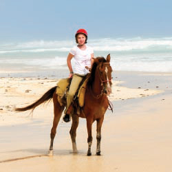Seaside Nature Park offers oceanfront horseback riding. // © 2013 Thinkstock