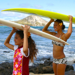 Waikiki is a great place for tweens and teens to take a surfing lesson. // © 2013 Oahu Visitors Bureau