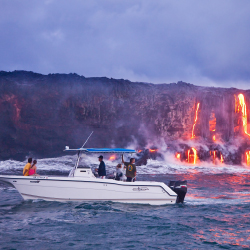 Hawaii Island's distinctive eco-adventures include lava boat tours. // © 2013 HTA/Tor Johnson