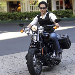 "On ""Hawaii Five-0,"" Chin Ho Kelly (played by Daniel Dae Kim) rides his motorcycle in the Hilton Hawaiian Village porte cochere. // © CBS"