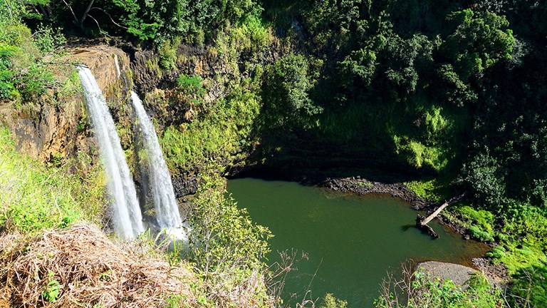 Tourist attractions, such as Wailua Falls on Kauai, are seeing far fewer visitors.