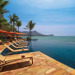 <p>Sheraton Waikiki's kids-free pool features rejuvenating views of Waikiki. // © 2014 Sheraton Waikiki</p><p>Pictured above: With cabanas, a swim-up...