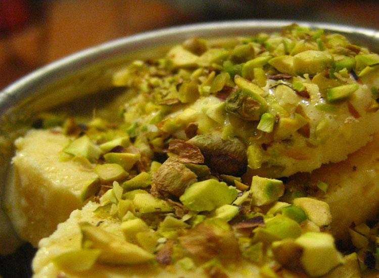 An Indian mango kulfi, topped with pistachios // © 2014 Creative Commons user shellfish