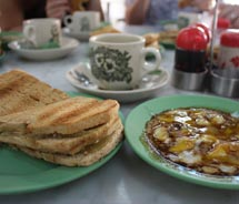 Ya Kun Kaya Toast serves up an authentically Singaporean breakfast of kaya toast, soft-boiled eggs and coffee. // © 2011 Deanna Ting