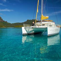 Tahiti Yacht Charter's fleet of French-manufactured catamarans can hold two to 8 guests on a private cruise. // (c) 2013 Tahiti Yacht Charter