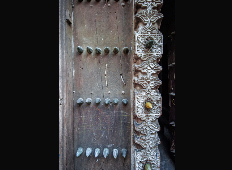 Large brass studs adorn many of Stone Town's doors. // (c) 2013 Bob Demyan