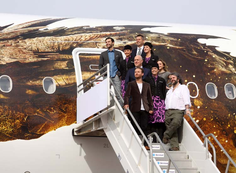 Director Peter Jackson (bottom right) at the unveiling of the Smaug plane at LAX // © 2013 Cody Geib