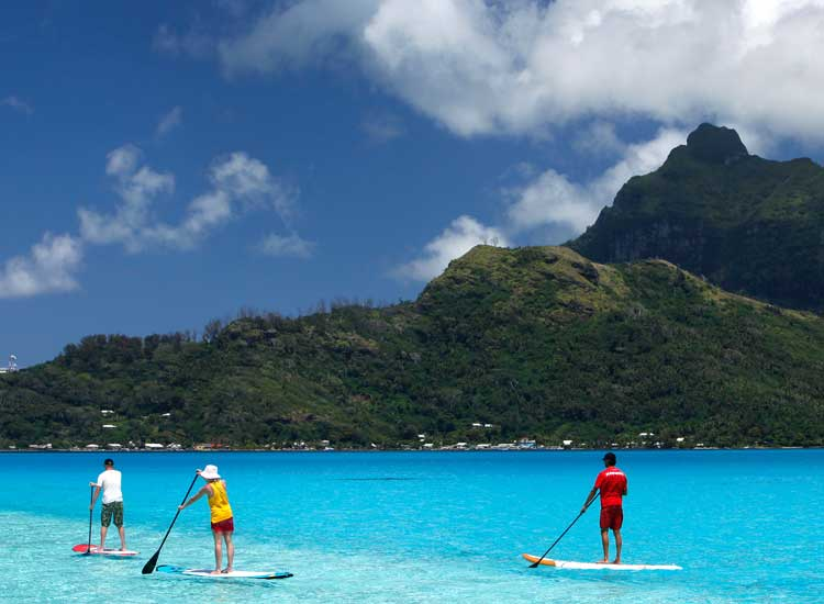 Stand-up paddle boarding is one of the many athetic events of the Bora Bora Liquid Festival. // (c) 2013 Wim Lippens