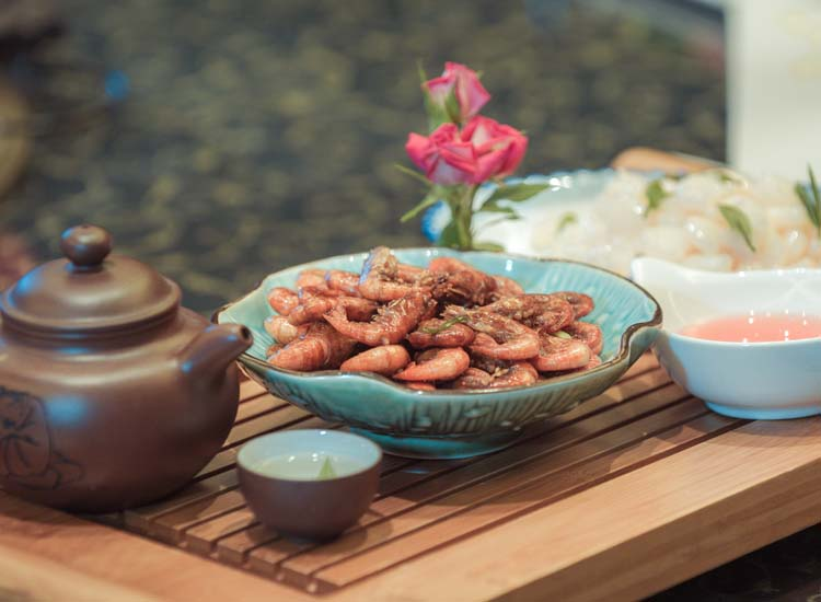 Long Jing shrimp, fried and flavored with Long Jing tea, is a Hangzhou favorite. // © 2014 Hangzhou Tourism Commission