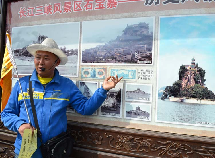 Century Cruises hires a local guide who explains the changes `has undergone since the Three Gorges Dam. // © 2013 Mindy Poder