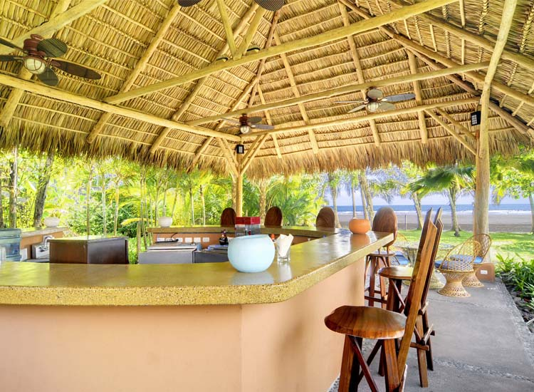 The open-air bar serves classic cocktails alongside specialties made with Costa Rica's sugar cane liquor, guaro. // © 2014 Alma Del Pacifico Beach Hotel & Spa