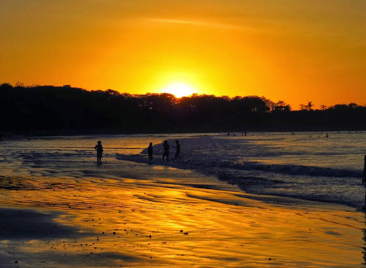 Sunset casts an orange glow on Tamarindo. // © 2014 Nikki Gloudeman