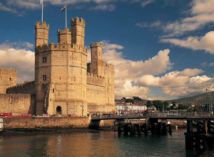 Wales' Caernarfon Castle, the location of the investiture of Prince Charles, is also included on itineraries. // © 2014 CIE Tours international