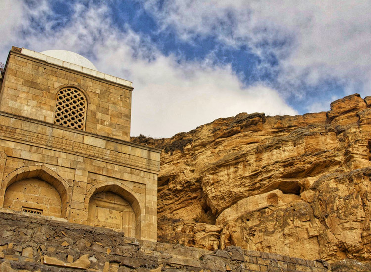 In Azerbaijan, the 15th-century Diri Baba Mausoleum sits on a cliff in the city of Mazara. // © 2014 Devin Galaudet