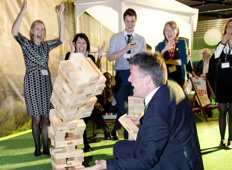 During the garden party, delegates played lawn games, including an oversized version of Jenga. // © 2014 VisitBritain