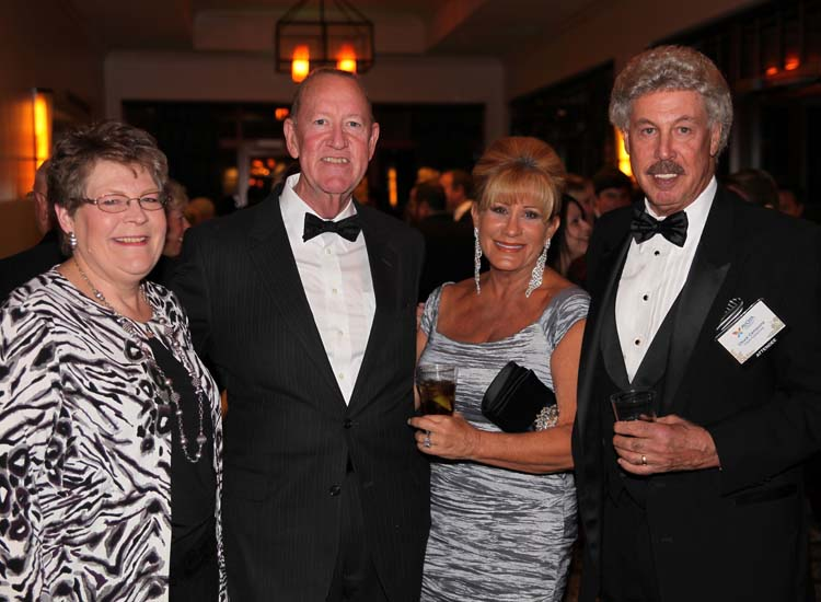 Independent affiliates Sue and Ernie Ratliff (left) with Chuck and Nysie Campione // © 2014 Avoya Travel