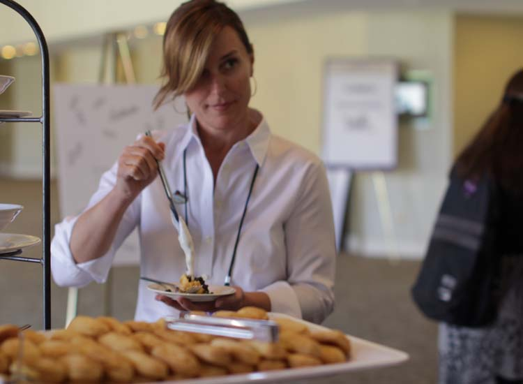 Protravel International's Sue Reddish makes her own eclair during a break hosted by Le Meridien. // © 2014 Eugene Ko