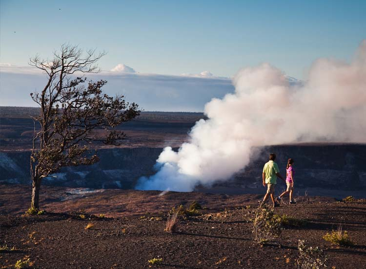 Hiking by a steaming crater is one of the most popular activities on Hawaii Island.  // © 2014 HTA/Tor Johnson