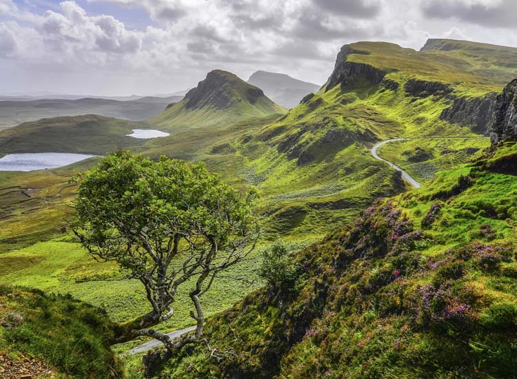 Hiking through the loch-filled Quiraing mountains is a popular activity on the Isle of Skye. // 2014 MartinM303/ Thinkstock