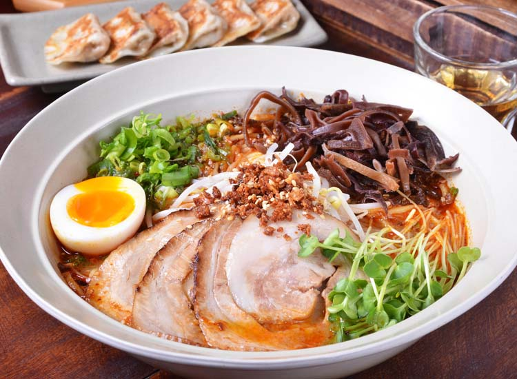 Ramen noodles can swim in different kinds of broth, such as tonkotsu, made from pork bone, and shoyu, made with soy sauce. // © 2014 Thinkstock