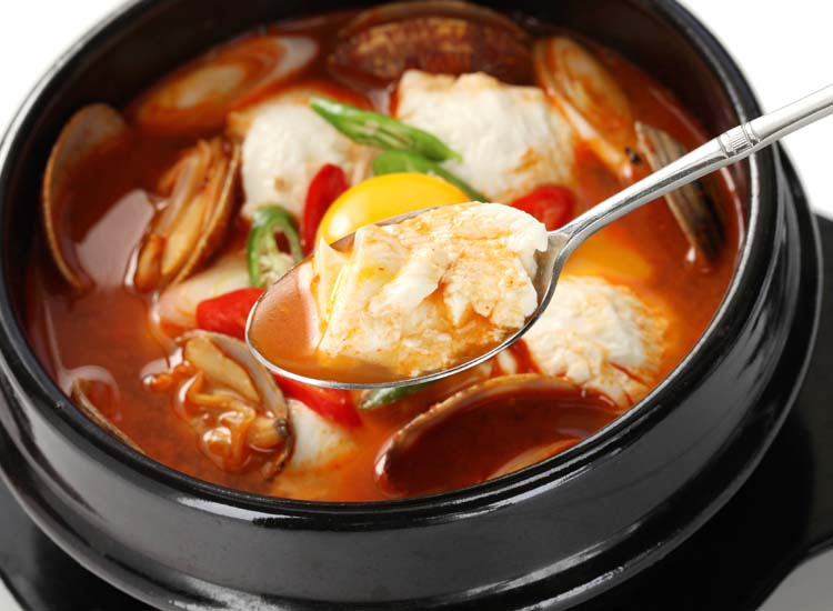 The broth of this tofu soup can be ordered at varying levels of spiciness, from mild to extra hot. // © 2014 Thinkstock