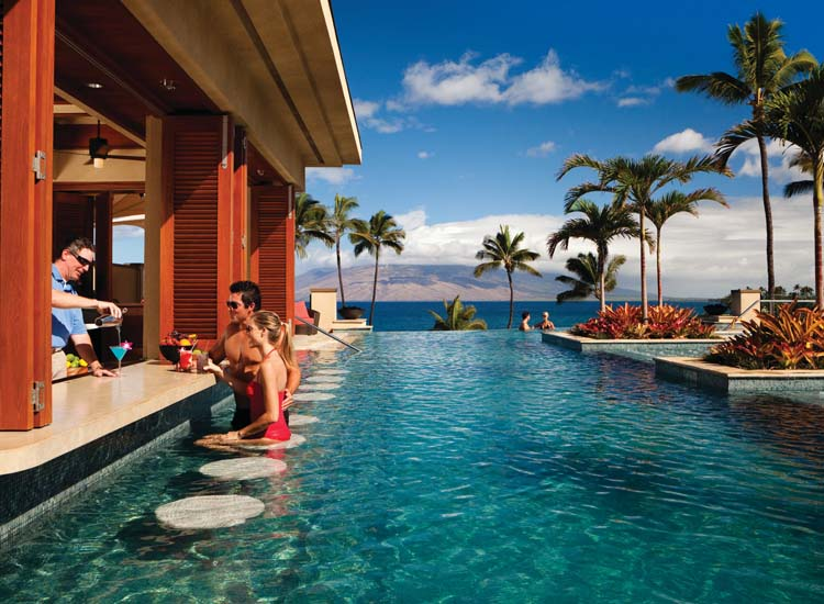 Realize your vacation dream of sipping a cocktail at the edge of an infinity pool at Four Seasons Resort Maui. // © 2014 Four Seasons Resort Maui