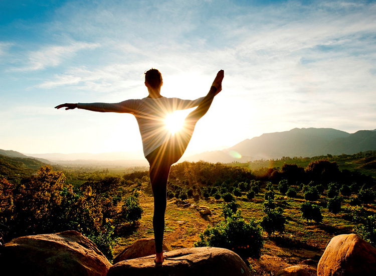 Outdoor yoga at Ojai Valley Inn & Spa combines physical fitness and meditation with stunning views of the Topatopa Mountain range. // © 2014 Ojai Valley Inn & Spa