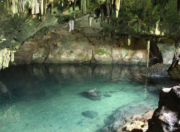Underground cenotes may have stalactites and stalagmites in addition to crystal-clear water. // (c) Irene Middleman Thomas