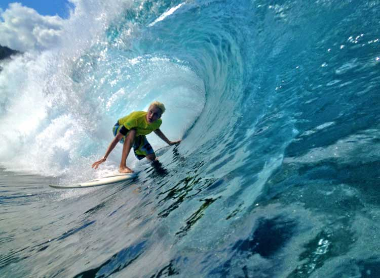 Professional surfer Keala Kennelly in a tube at Pipeline on the North Shore of Oahu // © 2014 Erik Ippel
