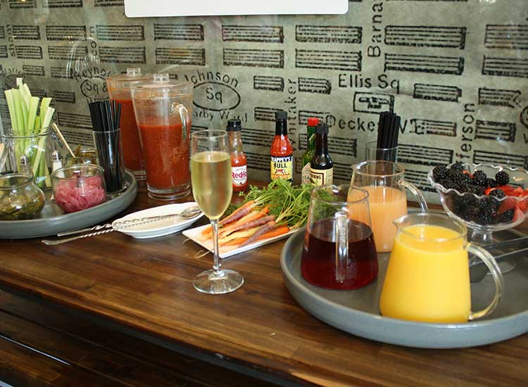 The make-your-own Bloody Mary and mimosa table is a popular spot at 22 Square. // © 2014 Nila Do Simon