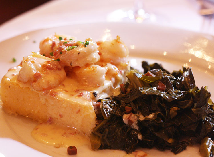 The shrimp and grits at The Olde Pink House has been voted as the city's best by local diners. // © 2014 Nila Do Simon