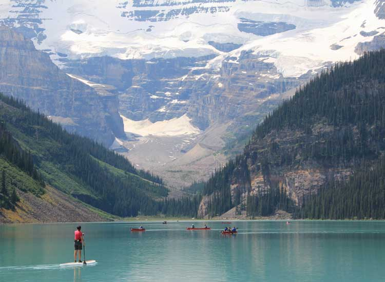 Lake Louise offers a variety of activities, including canoeing, stand-up paddleboarding and hiking around the lake. // © 2014 Tanya Koob