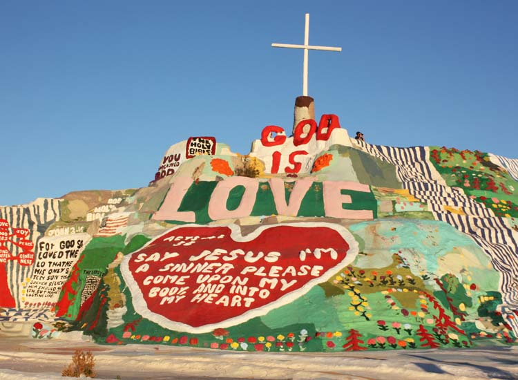 Religious or not, visitors trek out to Salvation Mountain to behold Leonard Knight's vivid homage to love. // © 2014 Mindy Poder