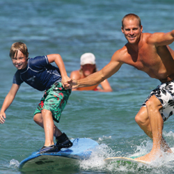 Hawaii is a great place for families to learn to surf together. // © 2013 Hans Hedemann Surf School